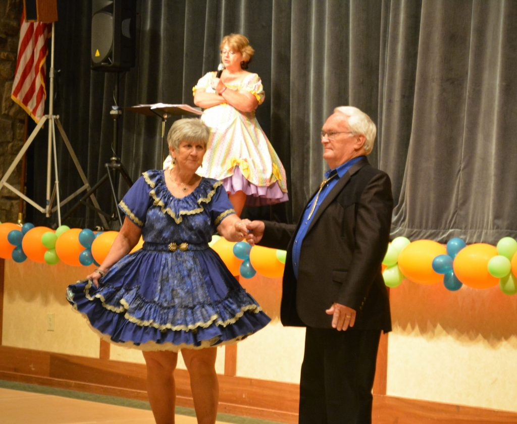 General Chairmen Glinda and Dan Torvik modeling the 70th NSDC outfit.